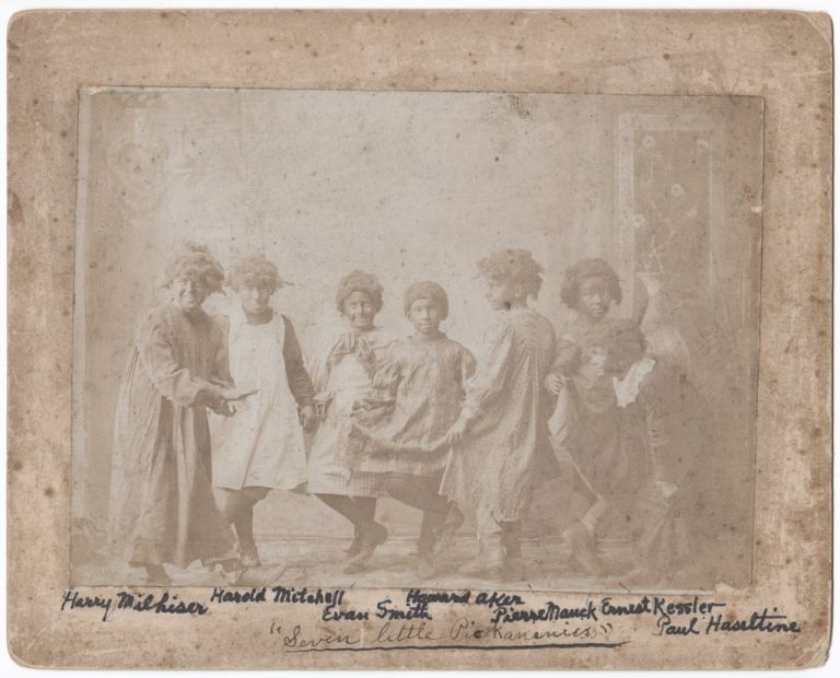 "[Annotated Photograph of Seven Young Boys in Blackface and Dresses, Captioned on Front in Autograph ""Seven Little Pickaninies""]. Racism."
