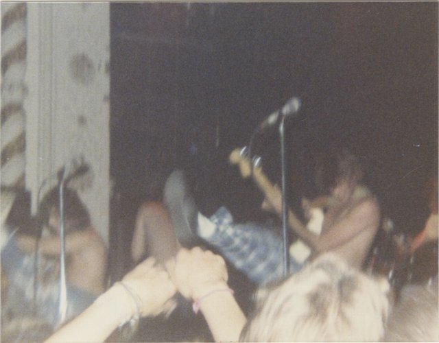 [Nine Original Vintage Photographs of an Early Butthole Surfers Performance]. Photography, Music.