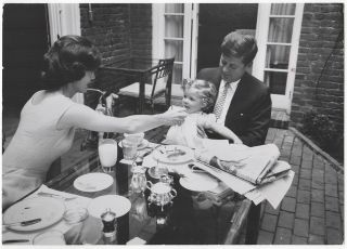 Photograph of John, Jackie and Caroline Kennedy at Their Georgetown Home in 1959