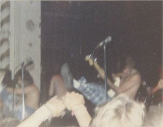Nine Original Vintage Photographs of an Early Butthole Surfers Performance